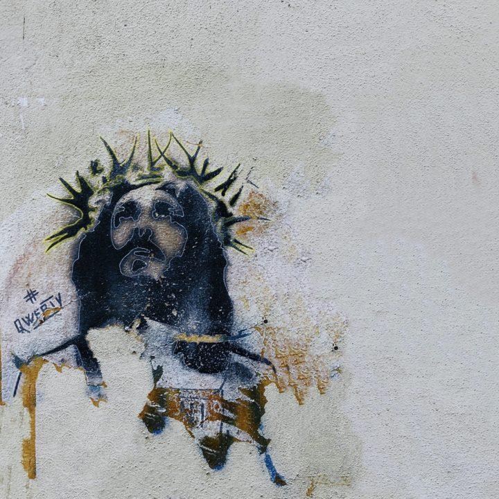 Jesusdarstellung als Graffity auf einer Wand.